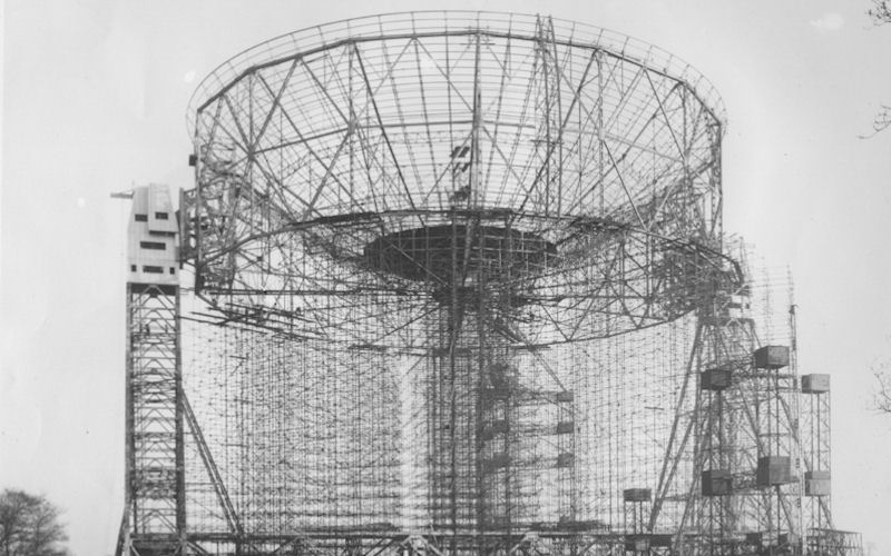 A black and white photograph of The Mark I Telescope under construction in the mid-1950s.
