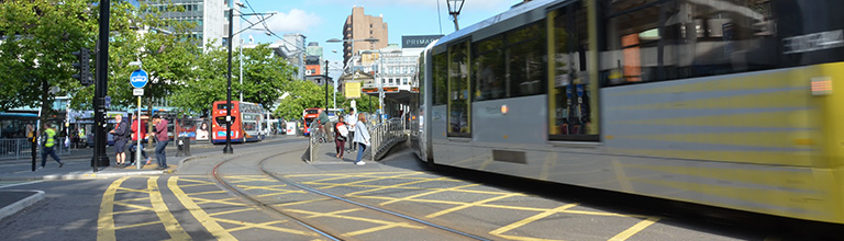 A moving tram in Manchester city centre