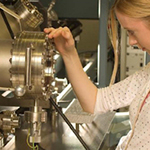 A female researcher operating nanoparticle spectroscopy equipment
