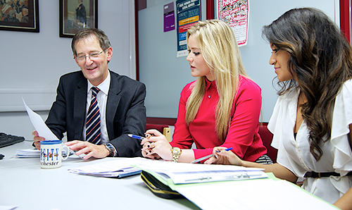 Two students in discussion with a careers advisor