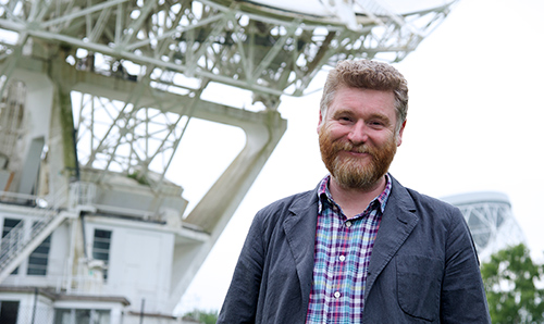 Professor Tim O'Brien in front of the Lovell Telescope
