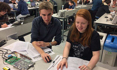 Female foundation year student being tutored by male undergraduate student