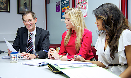Two female students talking to a careers advisor