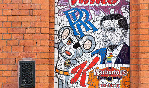 A mosaic of Manchester icons, including Alan Turing